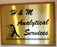 H & M ANALYTICAL – Black Filled Etched Brass Panel Mounted to a Wood Stained Panel in Allentown, PA