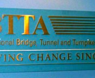 INTERNATIONAL BRIDGE TUNNEL and TURNIKE ASSOCIATION - Polished Brass Solid Letters Pin Mounted onto a Painted Wood Panel and Installed in Washington, DC