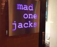 MAD ONE JACKS - LED Illuminated Aluminum Stencil Cut Sign with Purple Acrylic Back-up Panel shipped to Hoboken, NJ