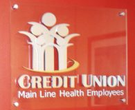MAIN LINE CREDIT UNION – Clear Acrylic Panel with Satin Aluminum & Brass Metalike™ Letters in Bryn Mawr, PA