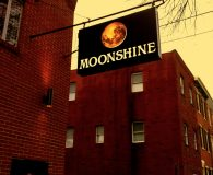 MOONSHINE - LED Illuminated Aluminum Stencil Cut Sign with White Acrylic Back-up Panel and Projecting Moon in Philadelphia