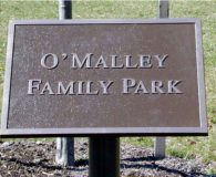 O'MALLEY FAMILY PARK – Cast Bronze Metal Plaque installed with Custom Bracket for an Angle Mount in Philadelphia