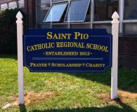 SAIT PIO'S – Paint Filled Carved Sign in Philadelphia